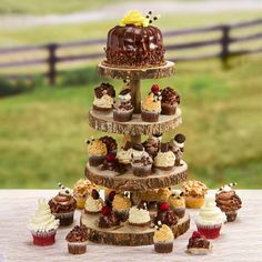 Get creative and wow your guests with a tiered cupcake display! | Rustic Cupcake Stand | Wood Slice Cupcake Stand | Rustic Wedding ideas | Wedding Cupcakes | Dessert Display | Reception Decor | #rusticwedding #weddingcupcakes