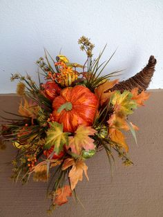 A cornucopia is a symbol of abundance, which was extremely important for the first settlers. It's perfect for Thanksgiving decor if you style it right. Thanksgiving Wreaths, Autumn Wreaths, Thanksgiving Decorations, Fall Decorations, Fall Floral Arrangements, Adornos Halloween, Fall Projects, Fall Flowers, Fall Harvest