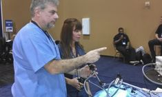2015 NAVC - Jimmy Burns demonstrating ESS rigid equipment to an Attendee (2)