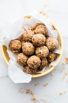 Cinnamon Toasted Coconut Bliss balls. A quick sweet and salty snack ball recipe made with toasted coconut, dates, cashews, and cinnamon! The perfect bite size healthy sweet treat. Paleo and Vegan friendly, crunchy, chewy, and and naturally sweetened.
