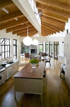 dining-rooms-kitchens-dark-wood-light-wood-white-exposed-beams-kitchen-islands-pendant