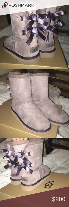 Uggs Brand new uggs ! Didnt fit me theses size 5 bow uggs run a little bigger than usual size 5 perhaps fits a size 7 foot (: have the box brand new selling for actual price because brand new !!! UGG Shoes Winter & Rain Boots