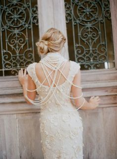 @Fellow Fellow Pettibone lace and layers of pearls make for an ultra-luxe and dramatic exit.