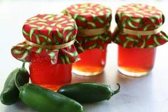Homemade jalapeno pepper jelly with no added pectin.  Jelly base comes from tart Granny Smith apples.  The addition of a few cranberries gives it a vibrant red color.