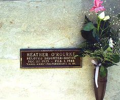 """The child actress from the movie """"Poltergeist,"""" is also here: Heather O'Rourke (1975-1988), who played 'Carol Anne', the little girl who was famous for the line """"They're here!."""" She is interred just below and to the left of Truman Capote, on the bottom row of the same wall. She died at age 13, on the operating table."""