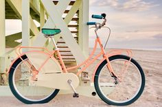 I want to live by the beach and ride a bike like this, and wear big circular hat.