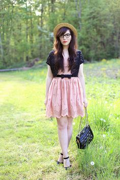 Pink eyelet, black lace, bow belt, long hair and straw hat!
