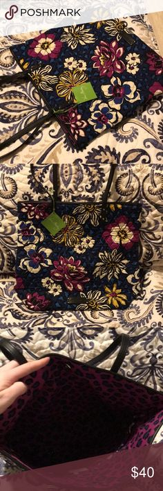 Vera Bradley Day Tote - African Violet A brand new with tags Vera Bradley Day Tote is up for sale! This tote - featuring fall 2014's popular African Violet patten - will surely stand out from the crowd! Perfect for school or work, as the magnetic closure and abs interior pockets will keep everything in place. Great for vacation or even daily errands. Vera Bradley Bags Totes