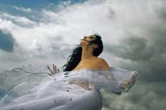 Beautiful white dress blowing in the wind.