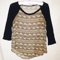 """LUSH Sheer Tribal Print Raglan Love this! Sheer taupe and black tribal print top with solid raglan style sleeves. Subtle hi-low cut. By Lush from Nordstrom. Size Small. Shell is 100% polyester. Contrast is 100% rayon. Made in USA. Chest measures 35"""". Length 24"""". Sleeve 19"""". Good pre-owned condition with no holes, rips, or stains.  KWs: boho chic, spring, layers, layering, striped, festival Lush Tops Blouses"""
