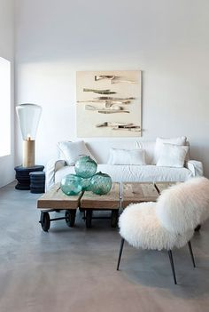 Eee, I'm crazy about this look! Super cool light, love the art, love the sea green glass, mostly white and cream but so cozy. love it!