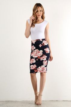 This cute navy floral pencil skirt is perfect for Spring! Made of 95% Polyester and 5% Spandex Sizing: Small: 2-4 Medium: 6-8 Large: 10-12 Length (measured from waist to hem): Small: 22.5 inches long