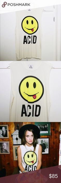 UNIF Acid Smiley Face Sleeveless Tank Top NWT UNIF Acid Smile Sleeveless Muscle Tee Size Small w/ oversized grunge fit. Purchased direct from UNIF & still in original packaging. Never worn or even tried on. Bought in size XS & S, only selling the Small 🦄 Cream distressed tank top with intentional holes. Pure perfection vibrant Smiley Face w/ UNIF Logo acid-tab on tongue Design 😋💥   Heighten your reality with this one-of-a-kind rare bb UNIF Tops Muscle Tees