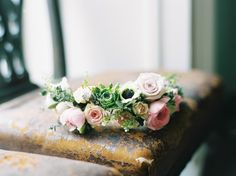 delicate floral crown on a distressed chair for boho bride look