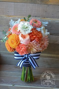 Orange and Peach Bouquet W/ Navy and White Striped Ribbon. Soleil Flowers, Temecula CA