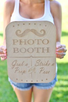 While you're keeping busy with your photographer, set up this photo sign by braggingbags via etsy next to your photo booth to send your guests in the right direction. #weddingsigns #photobooth