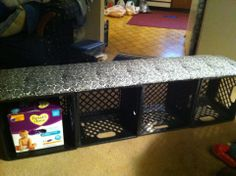 Milk crate bench. Great idea for the play room :)