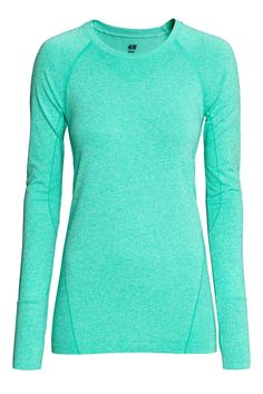 Seamless sports top: Fitted sports top in fast-drying, jacquard-patterned functional fabric with long raglan sleeves with wide ribbing and a thumbhole at the cuffs. Seamless.