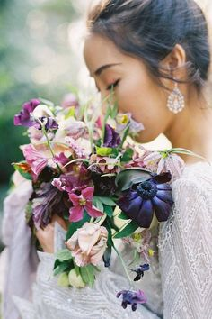 Jewel-toned flowers have our hearts. 💜 All of these rich florals by @honourandblessing are incredibly playful, but that slightly tinted blue bloom stole the show! ✨ | LBB Photography: @jenhuangbogan #stylemepretty #weddingflowers #bridalbouquet #weddingbouquet #springwedding