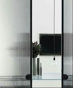 reeded glass as sliding doors for a wardrobe. ...simple detail