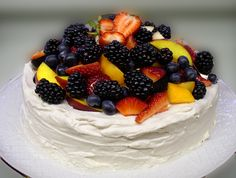 Pavlova - A meringue cake topped with sweetened whipped cream and lots of fresh fruit