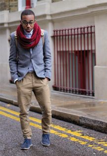 Cool look for a young man. Pastel blue blazer. Chino coloured trousers. Rucksack. Red scarf.