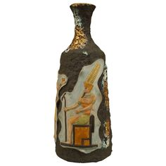 1930s Italian Egyptian Revival Lava Vase by Italo Casini | From a unique collection of antique and modern vases and vessels at https://www.1stdibs.com/furniture/decorative-objects/vases-vessels/