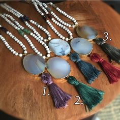 Natural Agate Stone Necklace These are great for layering or wearing as a single statement necklace. Made with turquoise white beads and an agate gold plated pendant with tassel.   Finished with Function&Fringe Signature gold feather charm with clasp.   Designed and made with ❤️ in California   Colors available  1. Purple w/amethyst  2. Green w/ aventurine  3. Grey w/labradorite   Please ask for a separate listing for the color you'd like   Other colors sold out Function & Fringe Jewelry…