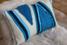 blue vintage shag pillow from wall hanging