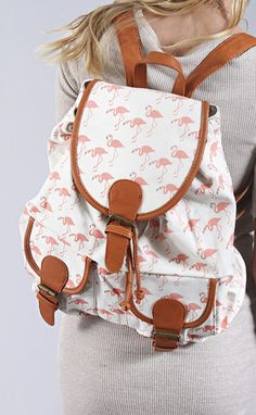 can't get over the flamingos?! neither can we! we love this print on the backpack & it measures 17x14x6""