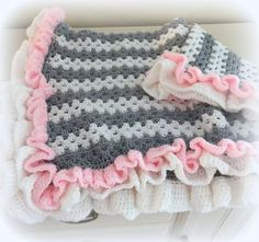 Crochet Baby Blanket Pattern ♥️ Little Granny Ruffle  ♥️ Crochet baby blanket pattern with beautiful ruffles! Adorable, fast and easy to make with a basic granny stitch.  ♥️ Cute stripes and sweet ruffles, change the colors for a baby boy or girl.  ♥️The finished size of this blanket is approximately 32 by 35 inches.  ♥️ Blanket is made with worsted weight yarn, and uses basic crochet stitches  in American Standard Terms ♥️  Pattern by Deborah O'Leary Patterns