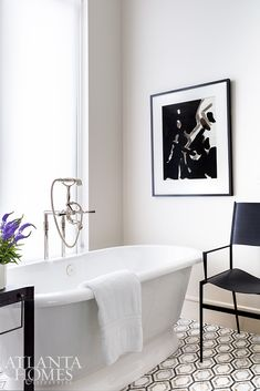 A shearling chair from B.D. Jeffries adds a finishing touch to the glamorous master bathroom. Barrel Vault Ceiling, High Rise Apartments, Harrison Design, Brass Side Table, Curved Walls, Paris Shopping, Brown Interior, Linen Sofa, Atlanta Homes