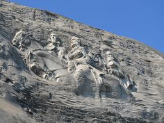 """Stone Mountain Park in Georgia- Confederate War Memorial. Huge carving on the side of Stone Mountain of President Jefferson Davis, General Robert E. Lee, and General Thomas """"Stonewall"""" Jackson."""
