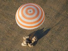 The spacecraft Soyuz TMA-04M lands in a remote area near the town of Arkalyk, Kazakhstan, on September 17.    The capsule carried three astronauts who returned to Earth after a five-month mission aboard the International Space Station.