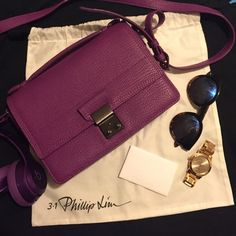 3.1 Phillip Lim Pashli Mini Messenger Pashli Mini Messenger in Orchid. Guaranteed authentic. Pebbled leather with canvas fabric lining and silver tone hardware. Adjustable shoulder strap. Two interior compartments and zip pocket. Fold-over flat top with push-lock closure. Exterior back pocket with magnetic closure. Original dust bag + care instruction card included. **ONLY USED TWICE. IN GREAT CONDITION. Few scratches on the push-lock closure metal but not noticeable unless closely…