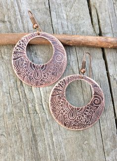 """Hand cut and etched copper hoops with a beautiful, detailed tribal pattern. After etching, the copper was lightly oxidized to bring out the detail in the pattern. The circle about 1.25"""" in diameter an"""