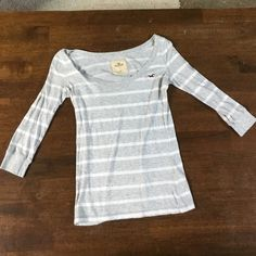 saleHollister gray and white striped shirt Hollister gray and white striped shirt. 3/4 sleeved Hollister Tops