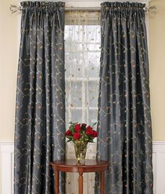 Curtains behind the shirred curtains really add a softness to the room