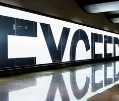 "BMW commissioned Serviceplan to design a billboard for the Hamburg airport.... illuminated billboard with letters half cut; the natural reflection of the sign on the shiny floor would now spell ""Exceed Maximum."""