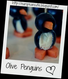 Olive Penguins Kiras on MyRecipeMagic.com are perfect for your holiday party. #appetizer #olive #penguin