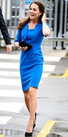 This dress is amazing! | DUCHESS CATHERINE | A royal in royal blue. The Duchess is all business in a bold suitlike L. K Bennett dress that shows off her trim figure, plus a black clutch, coordinating heels, a Cartier watch and Kiki McDonagh amethyst-and-diamond earrings, at the opening of the ICAP Art Room at a high school in Ealing, England.