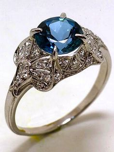 A twist on the classic wedding ring by having a beautiful blue topaz in the middle for a classical vintage look with a modern twist.
