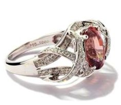 """At Clients Request, Light Champagne encrusted Diamonds, surround her own precious family's  Tourmaline,  fits the era of her stone (circa1918) yet is updated, by use of the """" ribboned"""" mounting, yes in Sterling."""