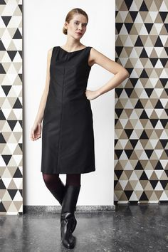 Little black dress with geometrical lines.