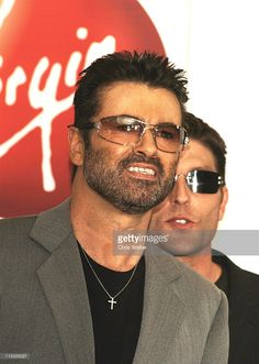 George Michael and Kenny Goss during George Michael In-Store Appearance for New CD 'Patience' at Virgin Megastore in Los Angeles, California, United States.