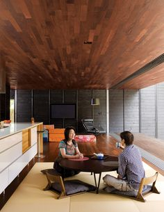 love the wood paneled ceilings and the flatscreen that blends into the charcoal wall