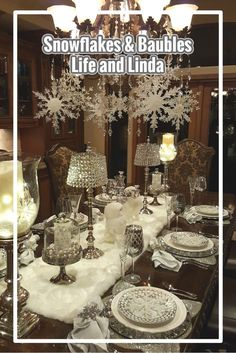 A lovely Holiday tablescape with snowflakes, silver and white.