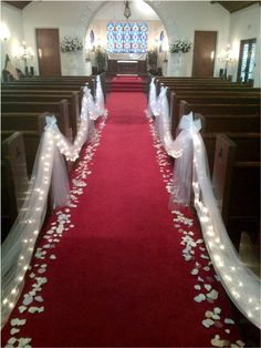Down the aisle – beautiful tulle, mini lites and lined with rose petals. - Down the aisle – beautiful tulle, mini lites and lined with rose petals. Down the aisle – beautiful tulle, mini lites and lined with rose petals. Wedding Chapel Decorations, Wedding Pews, Wedding Isles, Chapel Wedding, Wedding Chairs, Wedding Centerpieces, Wedding Table, Flower Centerpieces, Church Aisle Decorations Wedding