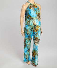 This jumpsuit is just a little bit wild, with a vibrant print and flowing lines. A full eye-catching look in one sleek package, this piece is sure to spice up the day.