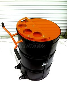 Recycled 55 gallon steel drum made into portable bar. Powder coated in HD colors, has casters to roll about on you deck or in your home.